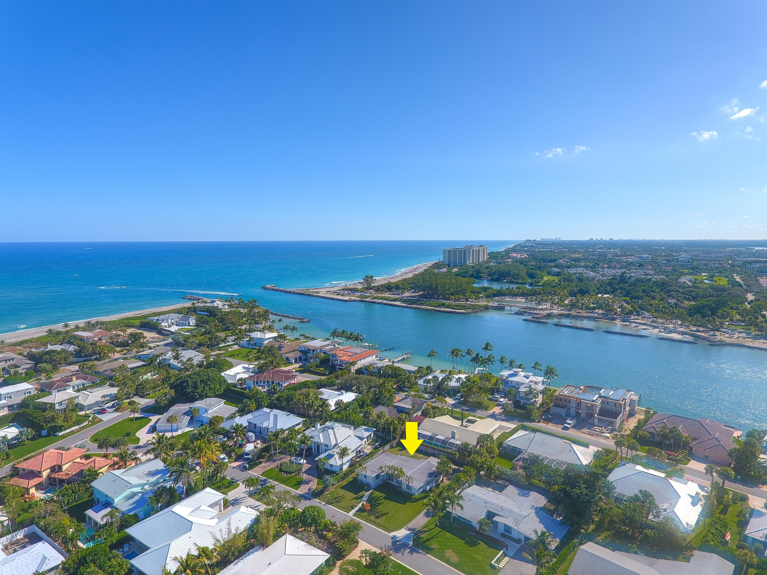 Live in paradise. Charming 3 bedroom, 2 bath beach home or build your dream home on this spacious lot in this desirable beach side community of Jupiter Inlet Colony. Community offers beach access with stunning turquoise, clear ocean waters. This neighborhood is a playground for snorkeling, paddle boarding, fishing and more.  Jupiter Inlet Colony is surrounded by the Atlantic Ocean, Intracoastal waters and Jupiter Inlet. Dogs are allowed on the beach with leash. Community is considered its own town with private police department within for the 243 home sites. Property is also available for annual, unfurnished rental. Call for details. JIB Club Marina with boat slips and beach club available for additional fees and or membership required.