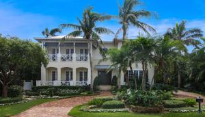 Designed in the classic British West Indies style and framed by lush landscaping, this luxury estate exudes curb appeal.
