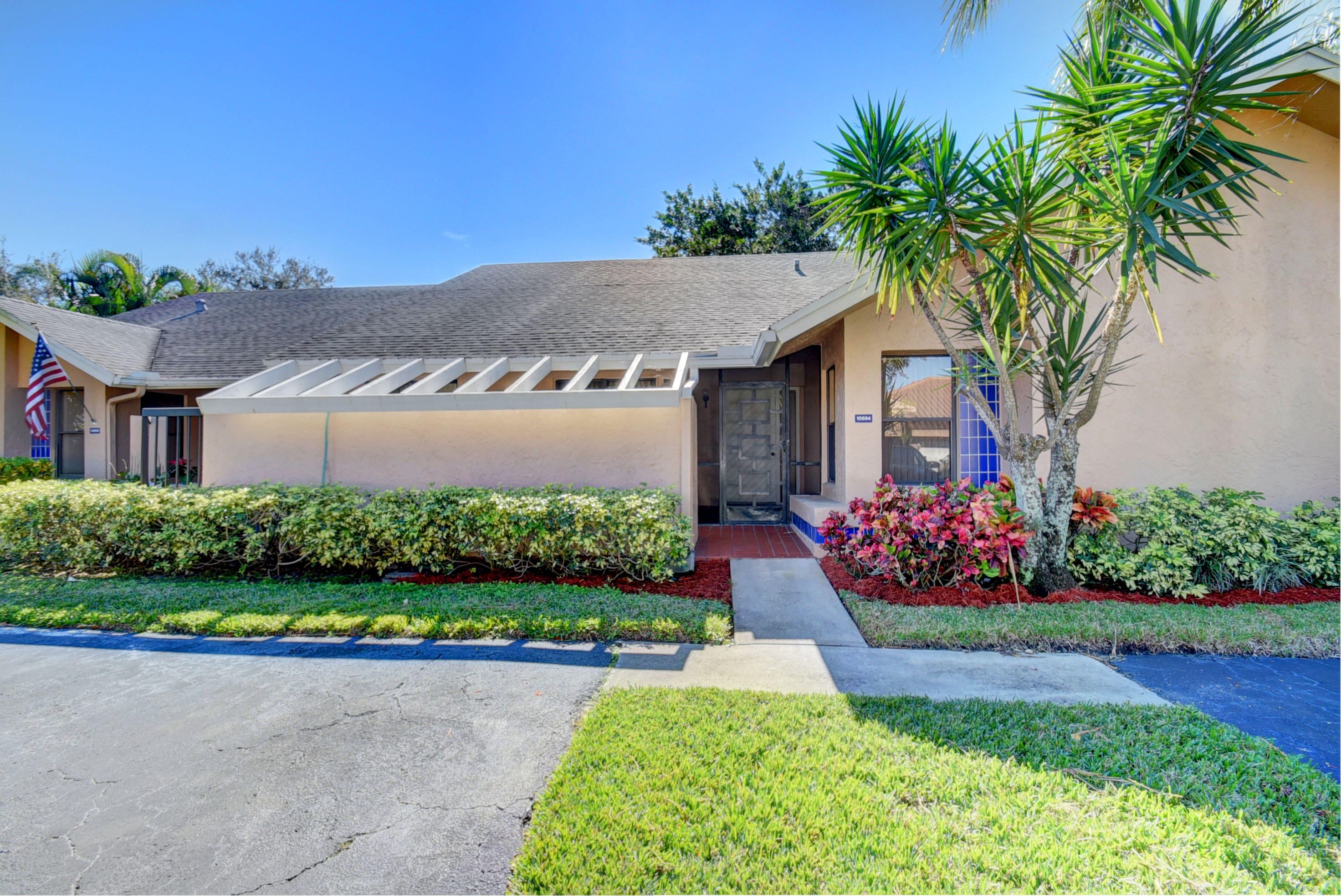 This incredibly pristine villa on a cul-de-sac features an eat-in-kitchen w/spacious breakfast area, large living room/dining room, & FLORIDA ROOM WITH A/C. The 14x13 master bedroom suite offers a large walk-in closet & master bath. There is a 12x11 2nd bedroom & bath, & interior laundry room. The charming Florida Room features impact glass doors with a view of gorgeous greenery. A/C - 2015. Roof - 2006. Atlas appliance contract.  Vaulted ceilings, lovely front patio, & 2 car parking right in front. Exterior painted in 2016. Active clubhouse, pool, tennis, sauna, fitness room, BBQ area, pier. Assoc says 55+ community. 2 pets welcome up to 20 lbs each. HOA covers exterior paint, lawn, cable, clubhouse, gate. Lovely West Boca area. Available unfurnished, furnished (negotiable), or turnkey.
