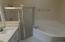 master bathroom with jacuzzi tub with separate shower