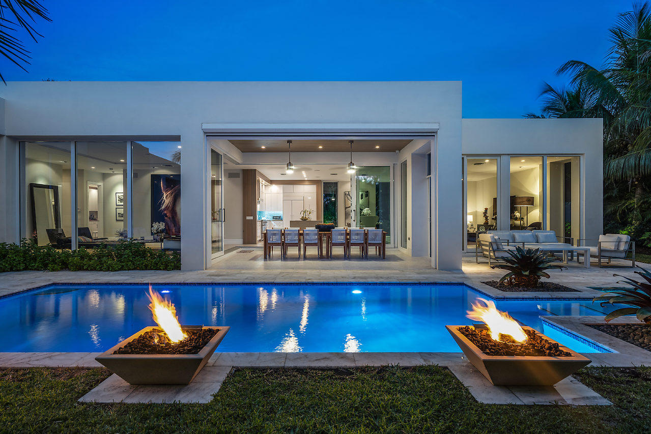 Modern Masterpiece beckons in Delray Beach on one of the most desirable, secluded streets in Lake Ida, minutes from the beach! This one-of-a-kind smart home with 4 BRs & 4.1 baths is punctuated by a sparkling resort-style pool & spa + 3,633+ sf of fabulous entertaining space, offering a laid-back vibe and sense of serenity, with a great flow between in & outdoors. Upgrades include 3 fire pits, water features, natural gas pool heater, in-pool fiber optics with 21 color choices + extensive outdoor lighting; all controlled via iPhone. A contemporary jewel by award-winning architect George Brewer offers the best of everything with a designer kitchen, deluxe master with spa bath, outdoor shower & 2 walk-in closets, Lutron lighting, A/V & security systems, climate controls, the list goes on. Modern Masterpiece beckons in Delray Beach on one of the most desirable and secluded streets in Lake Ida, minutes from the beach! This one-of-a-kind smart home with 4 bedrooms and 4.1 baths is punctuated by a sparkling resort-style pool and spa plus 3,633+ sf of fabulous entertaining spaces. Special upgrades include 3 fire pits, water features, a natural gas pool heater, incredible in-pool fiber optics to set the mood with 21 color choices, and extensive outdoor lighting; all controlled via iPhone.   A contemporary jewel by award-winning architect George Brewer offers the best of everything, with a designer chef's kitchen, deluxe master suite with a spa bath, outdoor shower and 2 walk-in closets, Lutron lighting, audio/visual and security systems, climate controls, the list goes on. This showplace of light, airiness and architecture gives a laid-back vibe and sense of serenity, with an intimate connection between the inside and outdoors.   Walls of glass overlook the lushly landscaped exterior and fill the home with natural light; while motorized shades allow you to control the ambiance. Chic, finely appointed living quarters provide ample room for hosting. A towering glass entry with