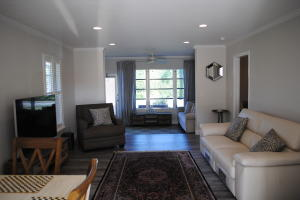 Open concept living, dining and lounging areas.