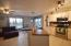 Eat-In Kitchen w/ breakfast bar, family room, and tons of natural light