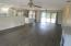 Large, living space opens thru sliders to 800 square foot, screened in patio and opens on the other side thru french doors to covered, 600 square foot screened porch.