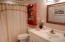 Main bath is updated and beautifully decorated. Furnishings are included in sale. Newer toilet and vanity in this bath as well. Notice the light over shower as well..