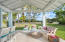 natural covered open pool cabana with summer kitchen, bar seating