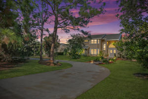 Large front yard with semi circular driveway.