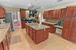 Fantastic chef's kitchen with huge center island, vegetable sink, plenty of storage, double ranges, 2 drawer dishwasher, French door