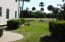 Here is the side yard, and again, it shows the greenery and beauty of a very well maintained yard and golf course just beyond the pond