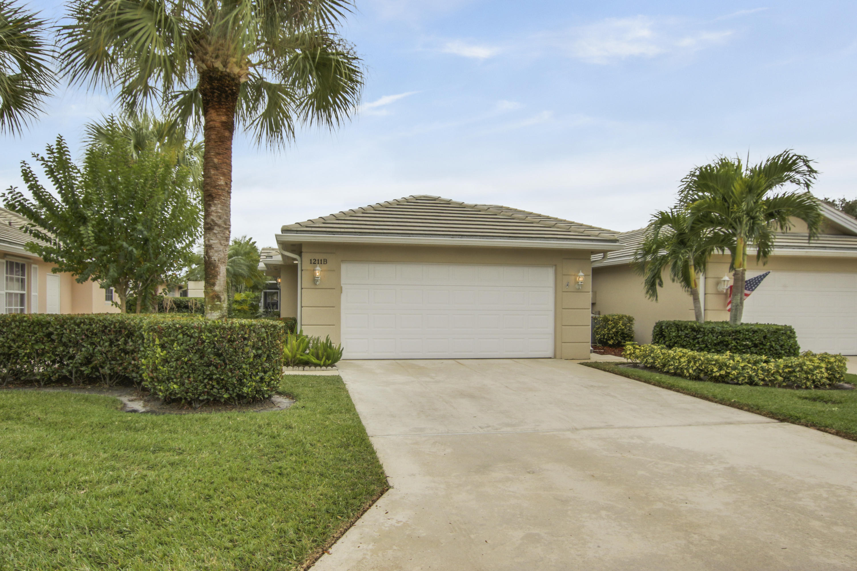 Welcome to the highly sought after Lakes at St. Lucie West; a Divosta community. This extended Capri model is built with solid concrete construction and has serene lake views. From the moment you enter the community you are greeted with beautiful oak tree lined streets and glistening lakes with sidewalks throughout the community for walking and biking. This villa is not to be missed! Features include two bedrooms, two bathrooms, kitchen with granite counter tops and new SS Frigidair appliances, spacious laundry room, two car garage and an oversided screened in lanai perfect for relaxing and entertaining while over looking the beautiful lake. Schedule your private showing today!