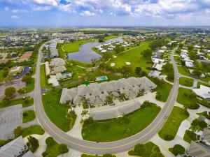 panoramic views of golf course and lake beyond