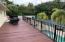 Full length deck off Master bedroomoverlooking pool and tennis court.