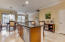 Stainless steel appliances and wood cabinets.