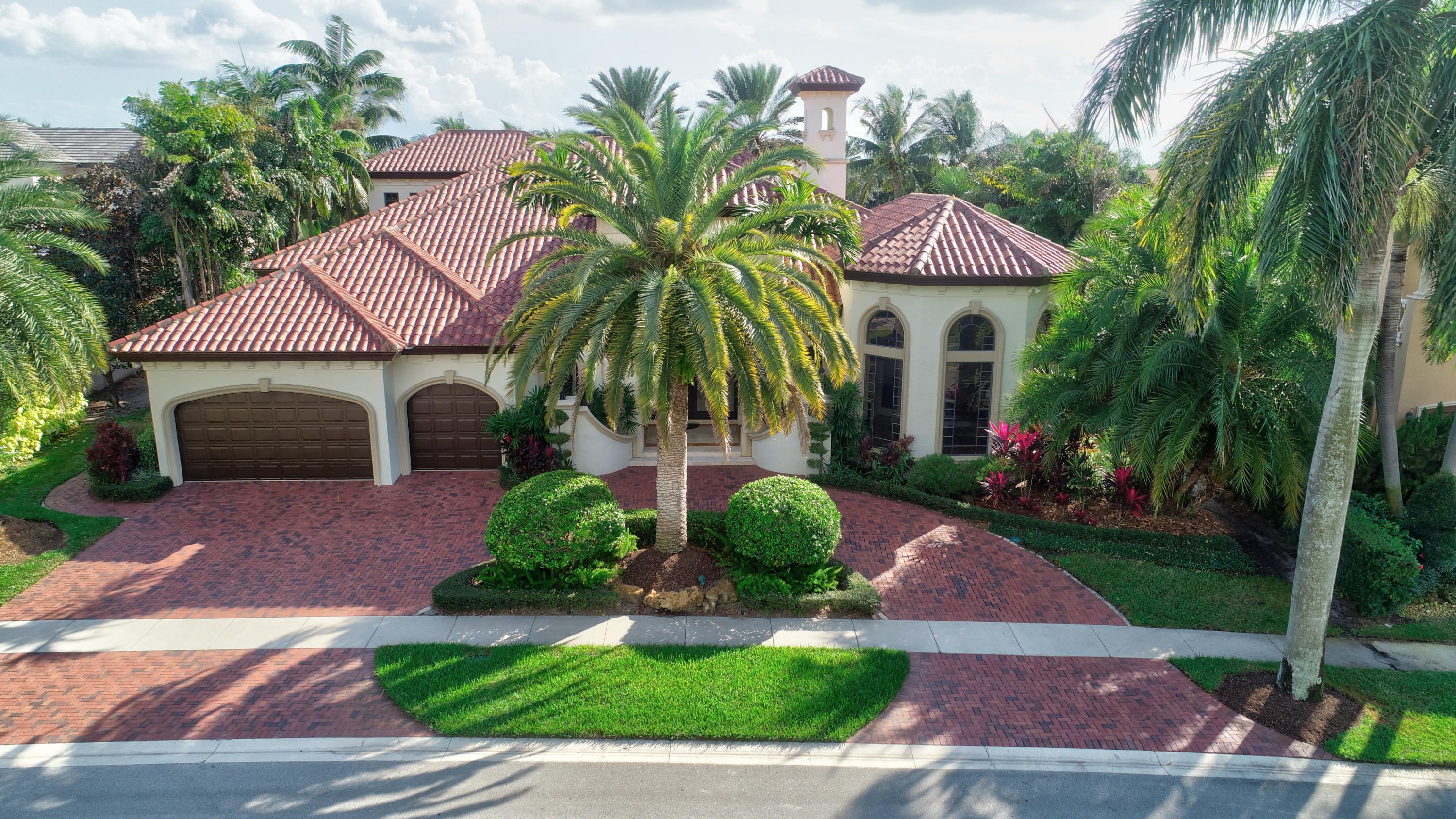 A masterpiece of classic Palm Beach design, this home is located in the exclusive enclave of DEL PRADO in MIZNER COUNTRY CLUB. Situated on a premier lot, this residence enjoys both serene golf and lake views. Resplendent in Old World details with 7700 total square feet, this spectacular home affords distinctive living and entertaining in unrivaled elegance and luxury. Extensive design elements include carved wood and stone columns, Venetian plastered walls, and custom stained glass accents. Lavish entertaining areas include a Grand Salon with fireplace and carved Mahogany bar, an elegant Dining Room with coffered ceiling, and a Billiard Room/Library with built-ins. The Family Room offers a beautiful custom built..... A masterpiece of classic Palm Beach design, this home is located in the exclusive enclave of DEL PRADO in MIZNER COUNTRY CLUB. Situated on a premier lot, this residence enjoys both serene golf and lake views. Resplendent in Old World details with 7700 total square feet, this spectacular home affords distinctive living and entertaining in unrivaled elegance and luxury. Extensive design elements include carved wood and stone columns, Venetian plastered walls, and custom stained glass accents. Lavish entertaining areas include a Grand Salon with fireplace and carved Mahogany bar, an elegant Dining Room with coffered ceiling, and a Billiard Room/Library with built-ins. The Family Room offers a beautiful custom built Media/Entertainment center. An expertly designed Kitchen features the finest in appliances, and offers a large pantry. A luxurious first floor Master Suite offers golf course views, and is grand in size with a sitting room and 2 custom closets. A sumptuous Master Bath is a special retreat with an ultra large Jacuzzi tub and two separate showers & commode spaces. Four additional en-suite Bedrooms are well appointed. Outdoors, an enchanting setting of mature and tropical landscaping provides for both formal and casual entertaining. A covered patio