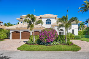 Beautiful home on rare corner lot in great location in Royal Palm Yacht Club.