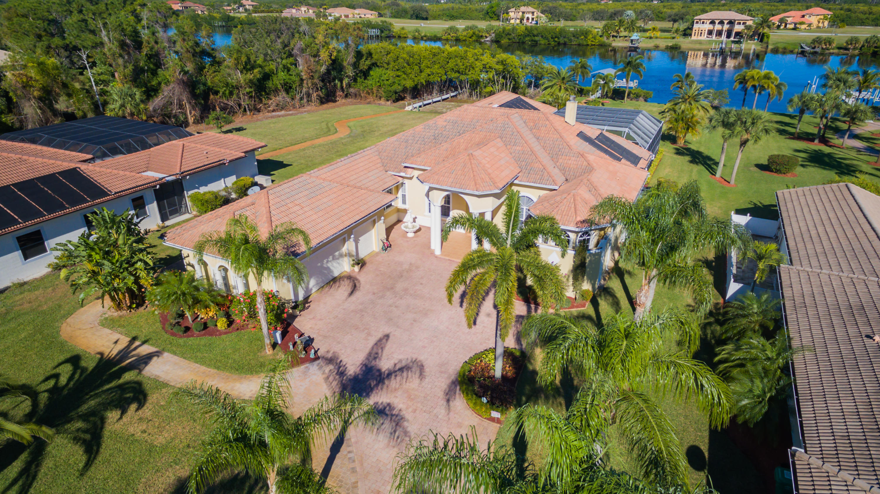 New listing in the gated waterfront community of Vikings Lookout.  This luxurious home is located on an acre off the North Fork of the St. Lucie River and features 6 bedrooms, 4 bathrooms and a 3 car garage with over 4,000 square feet under air!  This custom CBS home has plenty of room for a large family, entertaining, and hosting guests.  The large kitchen and pantry make it easy to prepare and serve meals, whether you are sitting at the counter bar, the kitchen nook with pool and river views, or the formal dining room.  Enjoy the sun and pool from the large screened pool which features an outdoor kitchen and plenty of seating areas.  Swim year round with three heat sources for the pool and spa!   Water features include a deep-water dock, boat lift, and the boat is available for purchase.