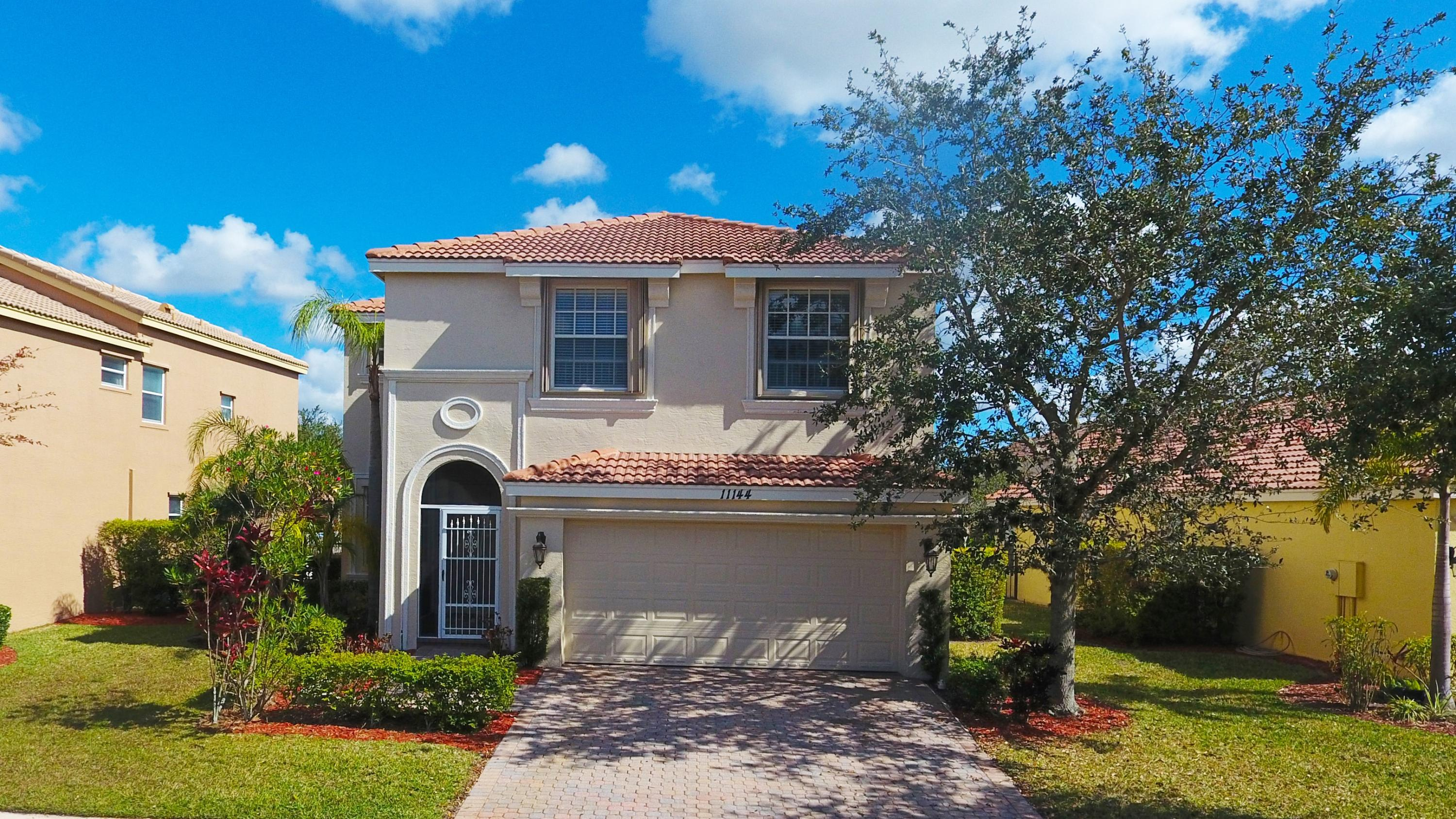 Welcome Home to highly desired Tradition! This 4 bedroom, 2 1/2 bath home boasts: freshly painted exterior and interior, screened front entry, new flooring in main living area, new kitchen appliances, abundant natural lighting, spacious master suite with walk in closet, upstairs windows feature child gates for safety, fenced in backyard, decorative driveway pavers and so much more.  Within walking distance to the clubhouse and pool. Moments from I-95 & Conveniently located close to everything!