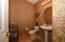 Spacious guest bathroom located in the first floor