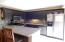Breakfast bar w/ stools fronts the open kitchen...great area to hang out, entertain or relax after work