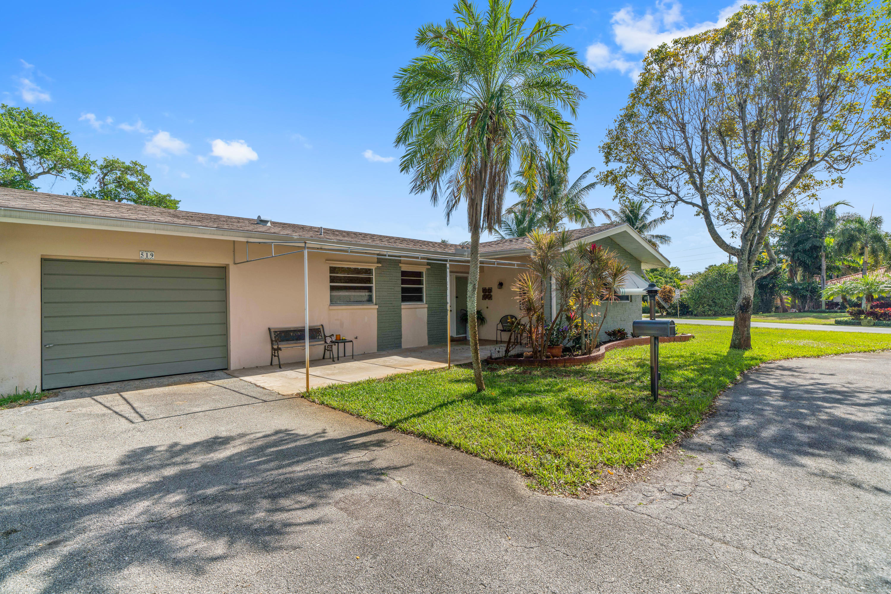Traditional Lake Ida home sitting on a corner lot on one of the neighborhood's nicest streets with excellent proximity to downtown and the beaches. Split bedroom floor plan with living room open to the Florida room. Charming home in a great location. New AC in 2018, roof replaced in 2005.