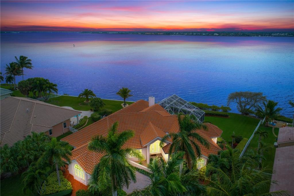 Amazing property that offers wide views of the St Lucie River, a slip with lift, three bedrooms, three and a half bathrooms and a gorgeous pool and spa. Casual elegance and your place in the sun is waiting for you. You will love the family room with fireplace and windows that offer views of the river. A NEW ROOF, travertine marble floors, an oversize master bedroom suite and cherry wood office, all make this the home you have been waiting for. Located in the sought after Sandpiper Bay area, this gated community offers golf and a 67 slip marina. Golf memberships are are available but not mandatory. Call today for your private showing and see why Ballantrae is the best kept secret on the Treasure Coast.