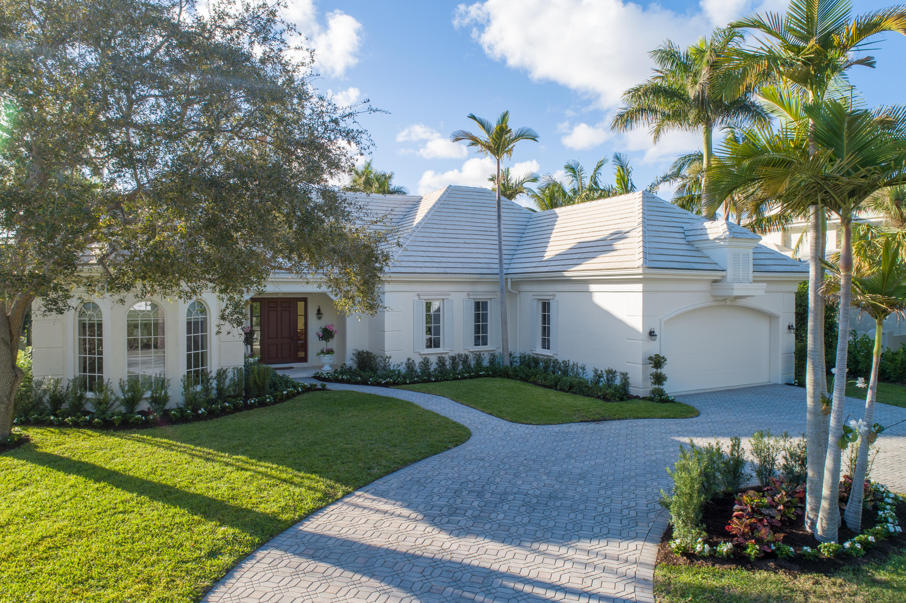Enjoy the South Florida Lifestyle in this Renovated, Upscale Gulf Stream HomeGulf Stream is a small, exclusive town in Palm Beach County with a population of fewer than 1000 residents. Located in a tranquil, safe enclave in the heart of Gulf Stream, this home will impress you with the quality craftsmanship & millwork that is highlighted in every room. With 3566-SF the home provides 5/BR-4/BA, a living  with fireplace, and a family room with wet bar for entertaining friends and family. The home's spaciousness is accented by vaulted, pecky cypress, coffered & volume tray ceilings as well as beautiful hardwood floors, wide crown moldings, and baseboards throughout, and every ground floor room opens out to the terrace through oversize sliding impact glass doors. The highly desirable open plan eat-in kitchen features a center-island prep area with a custom built-in wine rack, multiple granite counter tops and wood cabinetry with excellent storage space. The kitchen provides easy access to the formal dining room as well as to both the living and family room. The family room opens directly, through the impact glass sliding doors, to the covered lanai with pecky cypress ceiling & lights for poolside entertaining day or night.   You'll be impressed by the beautifully landscaped yard and on balmy Florida evenings, you'll enjoy the benefits of lovely ocean breezes coming off ocean and beach located just a block away.   The ground floor master bedroom has an expansive walk-in closet, a large master bath with raised step-up tub, a separate glass enclosed shower and marble floors. The upstairs bedrooms are perfect for guests or a growing family, allowing for quiet privacy away from the master bedroom below.   For families with school-age children, the home is located on the same street as the prestigious Gulf Stream School (PK-8) a few blocks away. The safety and security of the neighborhood provided by the town's police department means you'll have complete peace of mind, and yo
