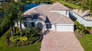 Extraordinary Estate home has over 4400 square feet under roof, 3684 ac on the best lake lot 75x167 with sidewalks. Imagine you go to a new home community and you get the best lot on water, on large cul-de-sac and you get everything you want and you design your dream pool 40x15 . Here it is already built for you, move-in ready at a great price. Dreams do come true:)