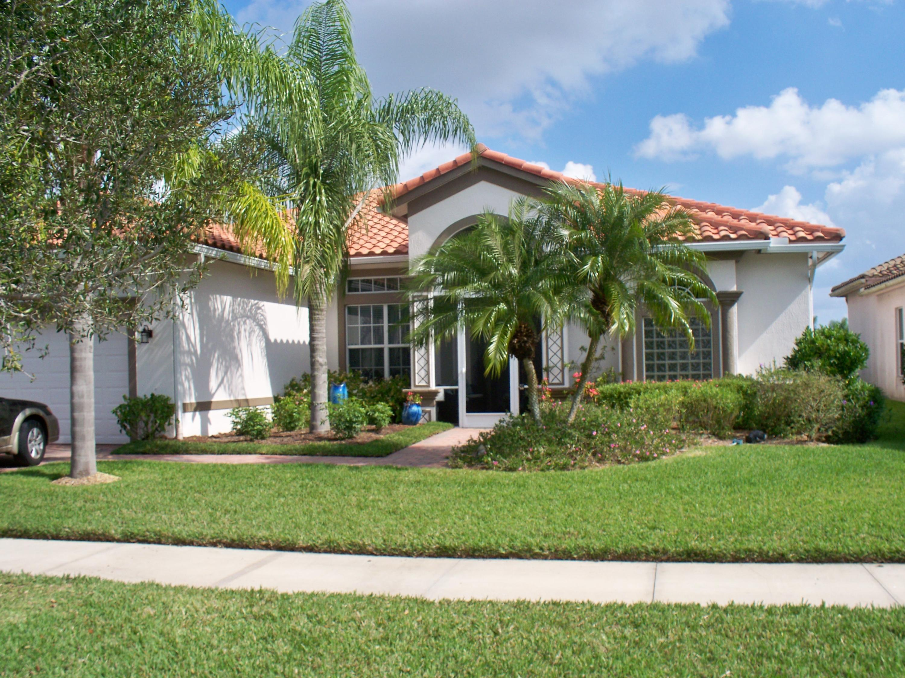 Just WOW! Discover this amazing  3/3 plus den lakefront pool home with so many upgrades -- a whole-house generator, new dual-zone A/Cs in 2017, fenced yard, tile everywhere, impact windows and doors, new refrigerator, and so much more! Watch the sun rise over the lake from your patio. Separate formal living and dining rooms flow into the open concept kitchen and family room, bathed in light from the clerestory windows and sliding glass doors. The master suite offers walk-in closets and a spa-like bath with raised cabinets and granite counters. Organizing will be a breeze with the large closets and built-in cabinetry. Tray ceilings accentuate the master, master bath and formal dining room. Vitalia is a vibrant 55+ community with a huge clubhouse, pickleball courts and other resort-style ame nities, including a putting green. This meticulously maintained home even includes 3 security cameras and 5 mounted televisions! Enjoy preparing food on your gas range, with all you need stored in 42-inch cabinets or the kitchen pantry -- no wire shelving here! Appliances are SS, counters are granite, and cleanup is easy thanks to the central vacuum system. In addition to the screened back patio, the front porch also is screened for those flow-through breezes. Brick paver driveway, walkways and patios frame the home. The pool is heated for year-round comfort, and all equipment is included. A complete gutter system efficiently wicks away stormwater, too! Truly a must-see home!