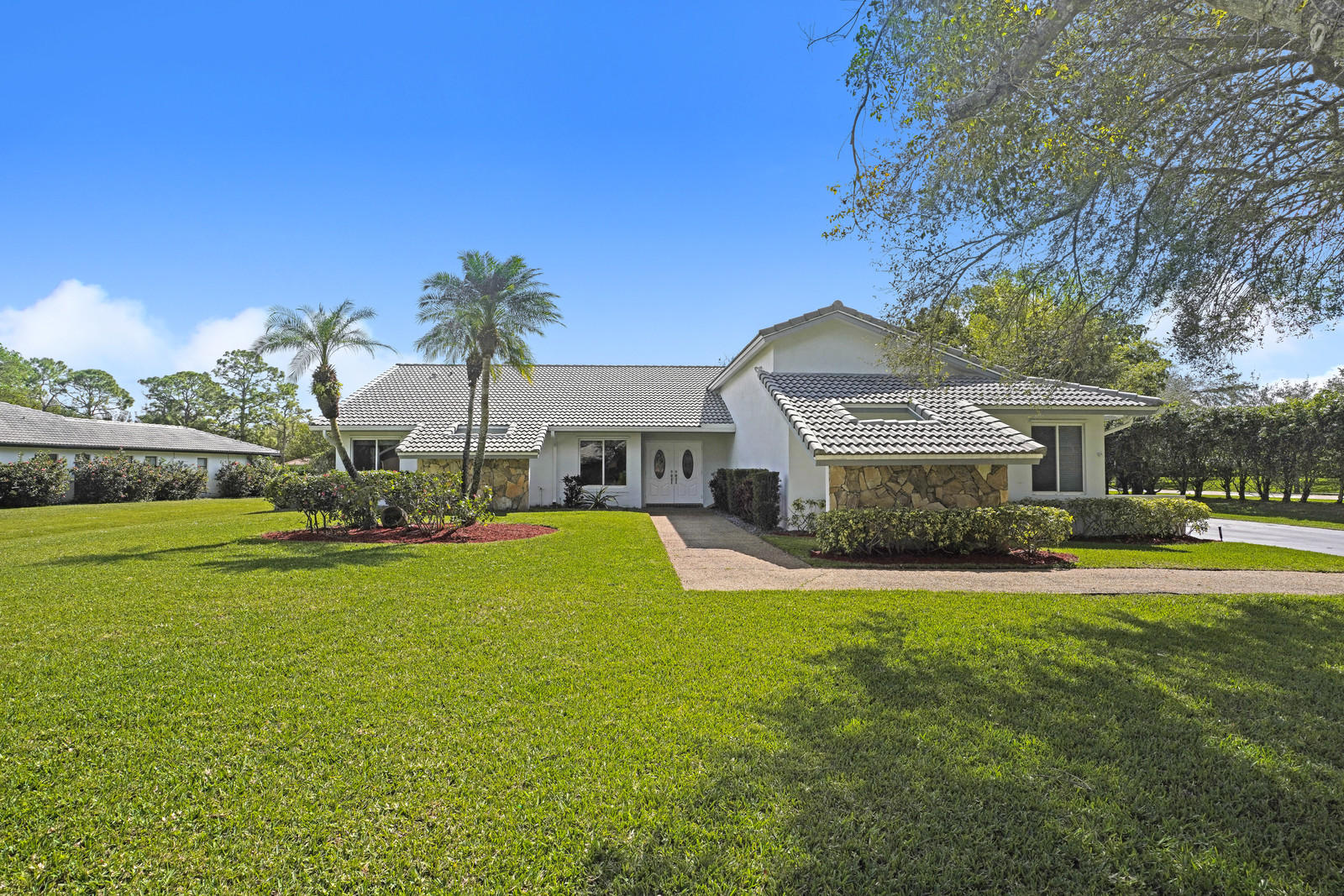 Tired of those zero lot line properties?  Here is your RARE opportunity to own your ACRE PLUS Estate Home in West Boca Raton!  Freshly painted one story house with new water heater, slide in hurricane shutters, extra long driveway, and A Rated Schools!  Priced to sell!  Come fall in love with this beautiful ranch style home!