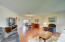 Beautiful laminate wood flooring enhances the beauty of this spacious room