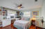 Guest bedroom offers built-in shelves and cabinetry