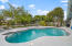 Pool and fenced deck overlooking panoramic waterway.