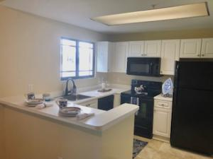 KITCHEN WITH BREAKFAST BAR AND WATERVIEW