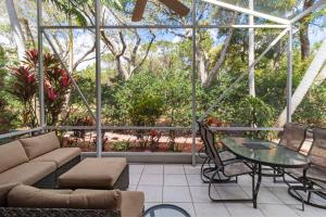 Tranquility defined! Patio overlooks a private wooded area with canal beyond