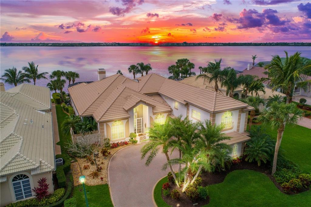 Welcome Home to your own piece of paradise. This wonderful pool and spa home, with sweeping views of the St Lucie River, offers 5 bedrooms, 2 offices, 7 bathrooms, 2 car garage, an outdoor kitchen, granite counters in kitchen and a sub zero refrigerator, marble floors, crown molding, lush landscaping, loads of storage, and a boat slip#18 and a 9,000 lb lift. There is plenty of room for entertaining family and friends. This community located in the sought after Sandpiper Bay, offers golf and a 67 slip marina, close to beaches, shopping, restaurants, and steps to Club Med Resort. Golf memberships are available but not mandatory. Call today for a private tour.