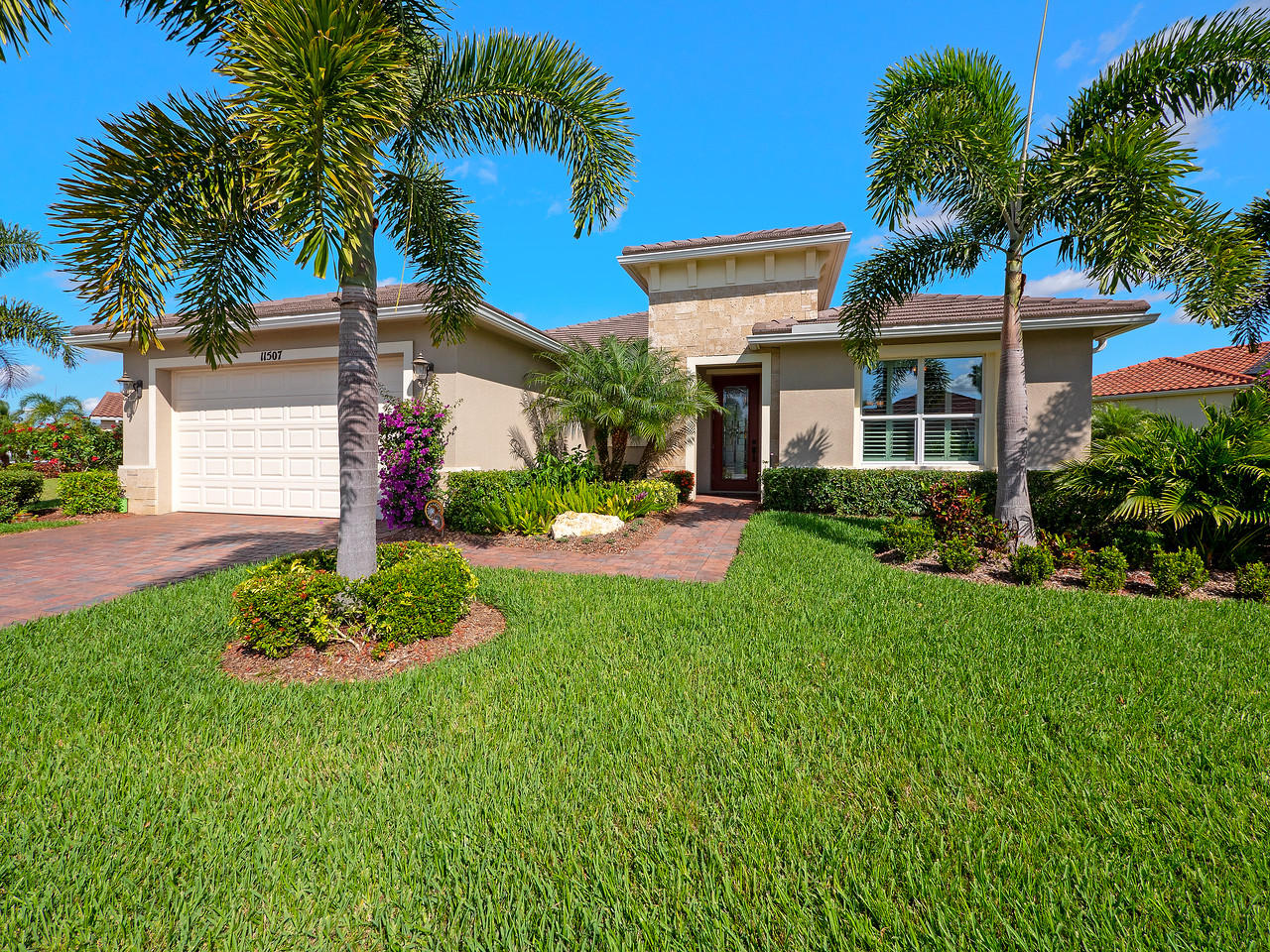 This sought-after ''Treasure Coast'' model, located in the upscale Estate Homes section of Tradition's Vitalia community, boasts an oversize lot, like-new condition having only been occupied since 2015. Features over $90k in upgrades including closet built-ins & kitchen cabinets,Crown Moulding,Phantom retracting patio door screens,granite counters,front impact glass,plantation shutters throughout,extended-length garage,serene lake view from extended/screened-in patio w/ceiling fans, extensive landscaping w/uplighting, spacious laundry room w/deep sink & cabinetry,new bedroom flooring,efficient gas water heater, alarm. All appliances are virtually brand new. Enjoy the good life at the extensive Clubhouse & Pool! Looking for a Quick Close? This home is picture perfect & move-in ready!