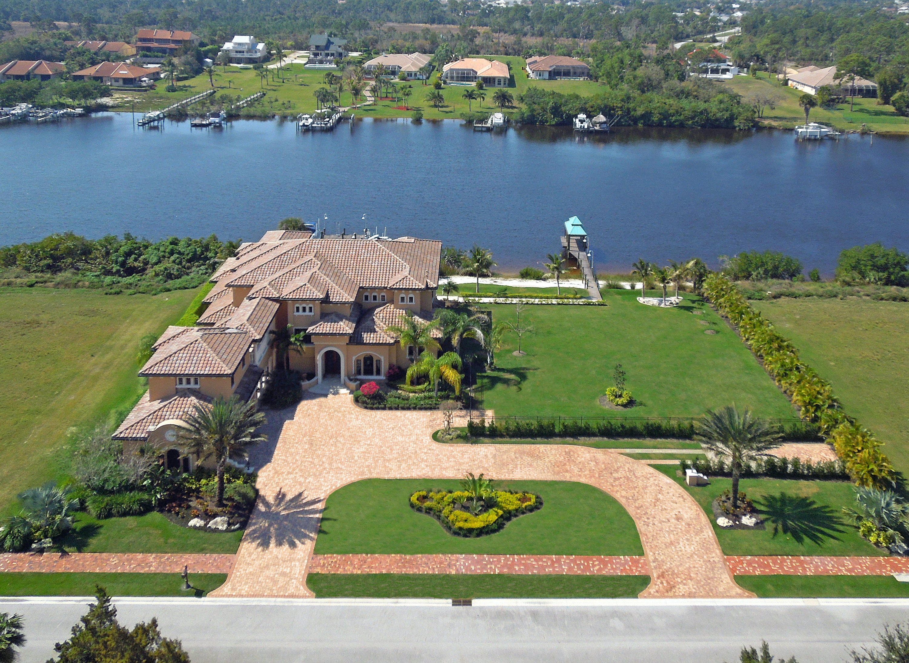 The Island of Ravello is a highly sought-after private development set on the breathtaking St. Lucie River at the southern end of St. Lucie County. This home is beautifully designed and packed full of upgrades like Brazilian hand-scraped wood working, wrought iron railings, Cast stone columns, custom draperies fans & light fixtures, extensive use of hardwoods throughout, 10ft front doors, impact glass throughout, Marble flooring with inlay accents, gourmet kitchen with Wolf, Sub-zero, and Asko appliances Theatre room, Elevator, state of the art audio/video, camera & AC thermostats, all bedrooms have covered balconies, bathrooms and walk-in closets, RV/boat storage with 30amp hook-up w/sewer cleanout, 2 deep water docks with boat lift and 2 jet ski lifts, furniture negotiable.
