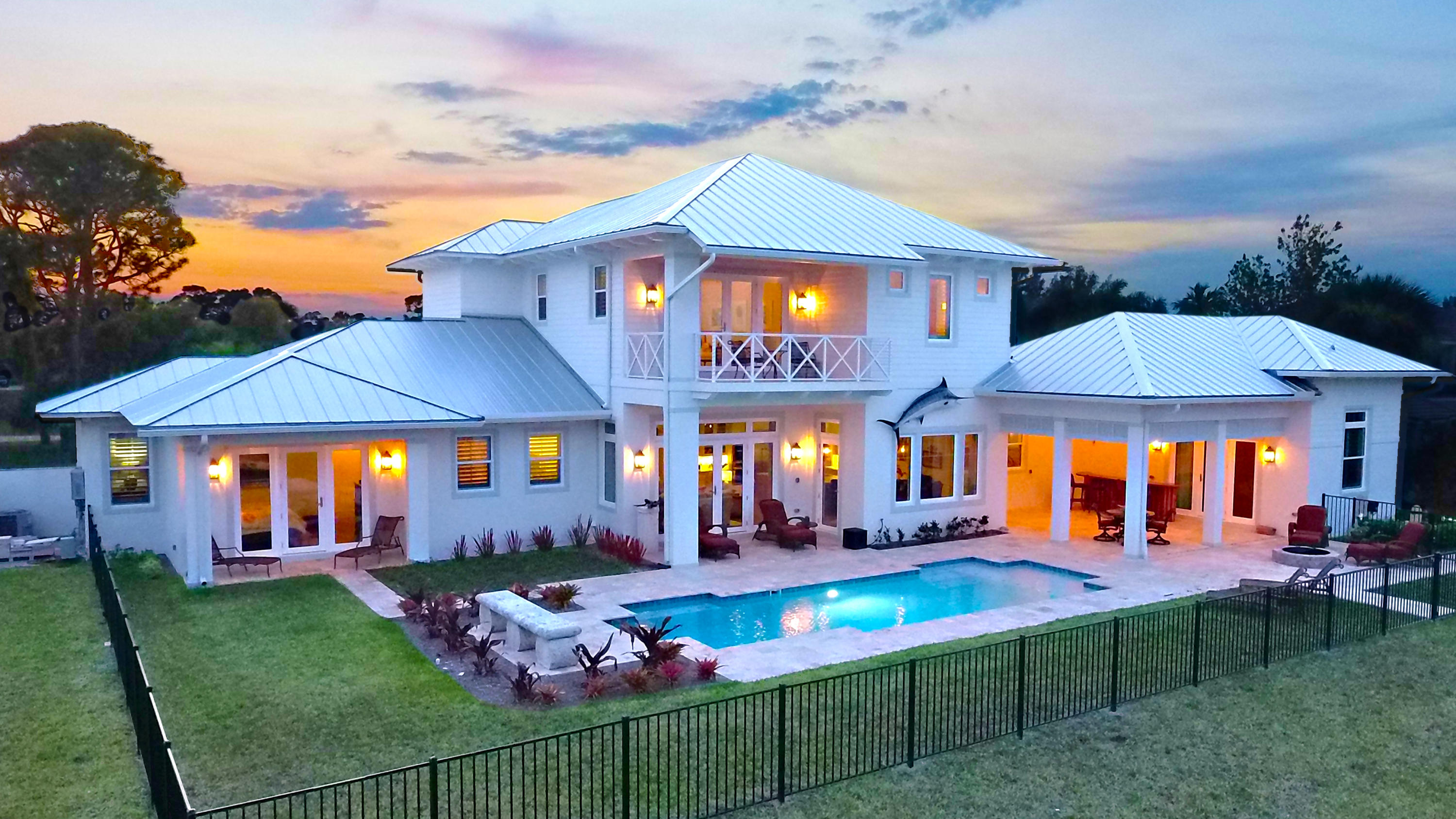 This stunning Waterfront Ocean Access pool home in the gated community of Bay St Lucie brings coastal living to a whole new level!  Just completed in May 2018, this 4 bedroom 4.1 bath home features the finest in finishes, including volume ceilings finished with beautiful beam work & Shiplap walls in all main living areas, the Masted Bedroom and Bath. Gourmet Kitchen features include etched Quartz island countertop, steam and duel ovens, gas stove, and dry bar all overlooking the beautiful St Lucie River.  The private separate Guest Cottage features a nautical themed bedroom and full bath just off the huge covered Lanai.  The deepwater dock features both 24K and 9K pound boat lifts, along with a much larger slip for yacht dockage. This home is a jaw-dropper with an amazing focus on details!