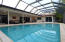 Large screened pool overlooking lush golf course.