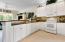 Granite countertops add beauty to this amazing kitchen