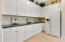Crown molding and beautiful wood detail added to this kitchen