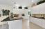 Kitchen offers an abundance of beautiful cabinetry