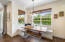Breakfast nook has a built-in banquette with storage