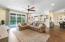 Great room has recessed lighting, wood floors, and is open to both the dining room and kitchen