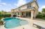 Enjoy the sun ledge and freeform saltwater pool