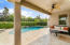 Covered patio overlooking the pool area (child fence comes with the pool)