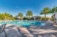 Resort-style swimming pool and sun deck with shaded cabanas