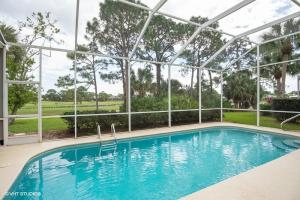 Screened private pool , covered lanai with an awesome Eastern exposure.