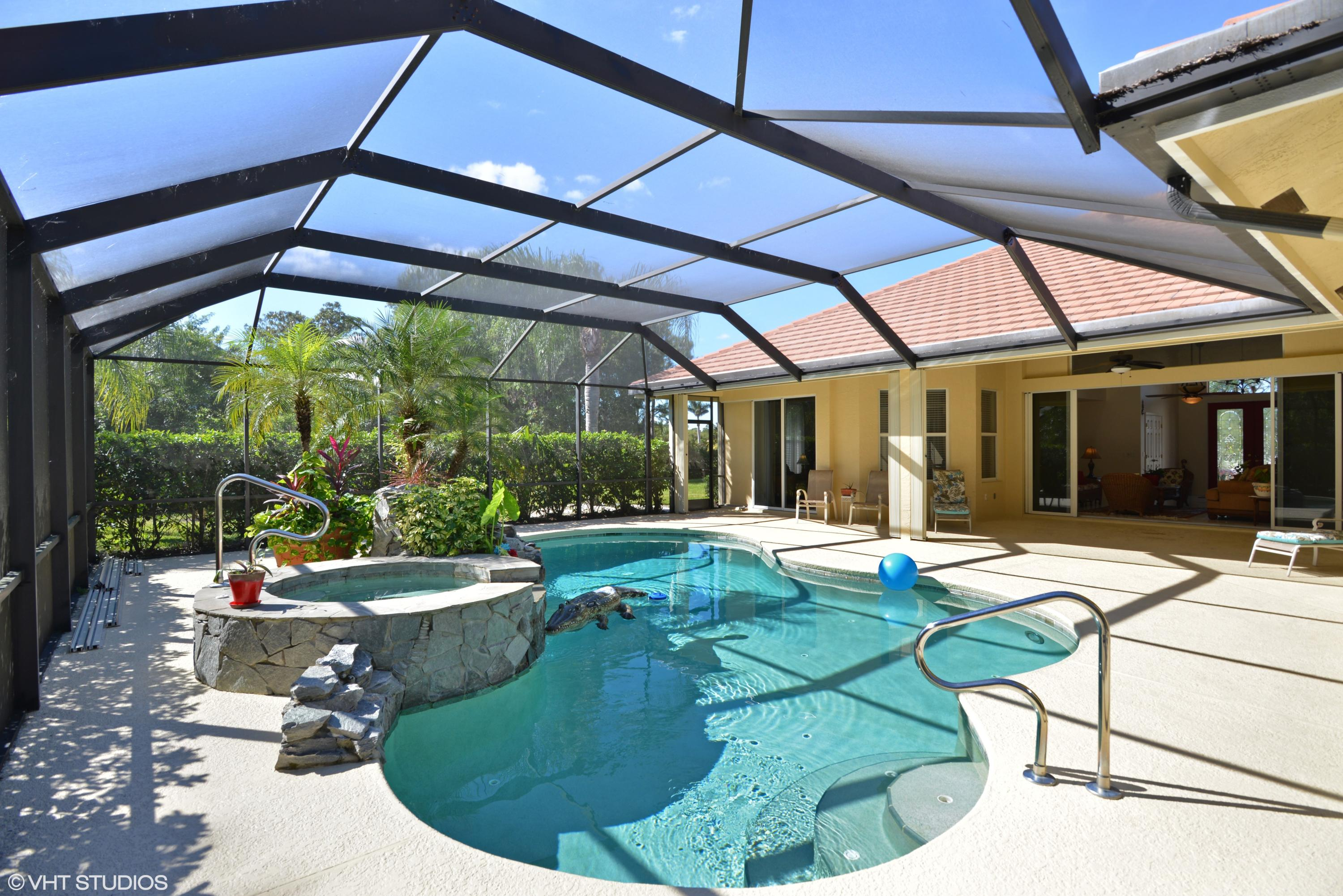 Quick close.Executive home on lush private estate lot. Large covered screened lanai, heated pool and spa with slate waterfall. CBS construction, 3 bedroom, 3 bath 3 car garage home in PGA Village.  Updates include granite kitchen countertops, subway tile backsplash,  new flat tile roof 2017, interior and exterior painted and much more.HOA includes the Island Club at PGA Village with pool, exercise room, tennis, pickleball, basketball, picnic area and social activities. PGA Village has 3 Champion Golf courses open to the public and several different memberships are available plus the private Legacy Golf Course. (Golf membership is not mandatory.) Only minutes from St Lucie West where you can find many restaurants, shopping, movies, bowling, medical facilities. Home of the NY Mets Spring Training. The Treasure Coast has amazing waterways for boating, fishing & beaches and located only 45 minutes to PBI. Looking for offers.
