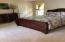Beautifully Decorated Master Bedroom Suite With View of Pool